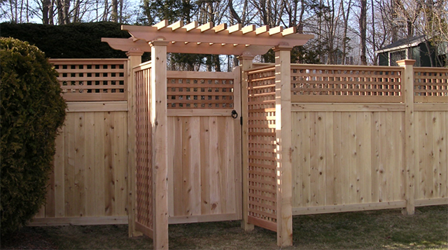 Cedar board and lattice fence and gate with pergola